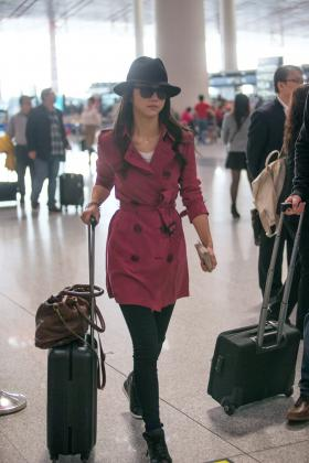 Tang Wei wearing Burberry at Beijing Capital International Airport on her way to